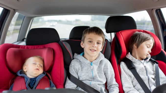 Children properly restrained in child safety seats